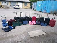 Large selection of suit cases