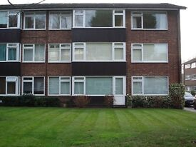 Two bed, top floor flat opposite Guildford's Stoke Park. 10mins High St. & London Rd Train Station