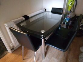 Black glass dinning table and chairs