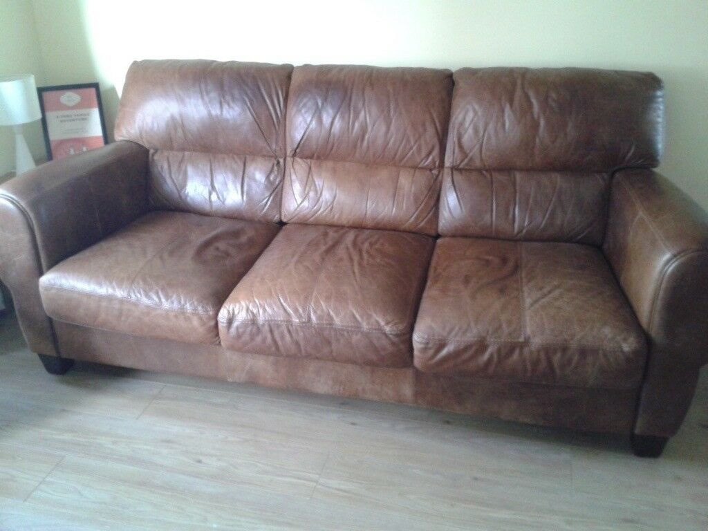 Leather sofa, armchair and storage footstool for sale