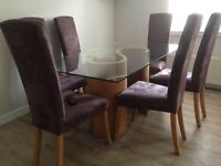 Tom Schneider glass dining table with oak base and 6 chairs