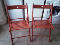 2 fold up kitchen dining chairs. Handy for visitors
