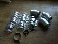 Lots of stainless steel flue brackets