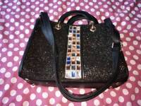 Black and sparkly bag
