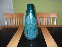 Large glass vase.