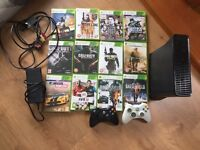 Xbox 360, with 12 games and 2 consoles