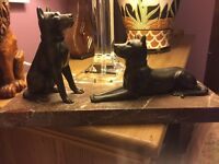 Dogs on marble plinth