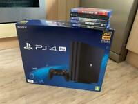 Boxed 1tb PS4 Pro + 5 games