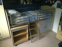 Cabin single bed with pull out desk, ladder and cupboard.