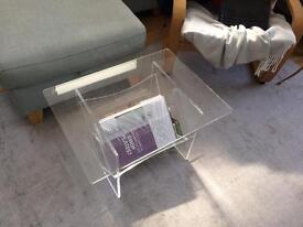 Transparent acrylic coffee table with magazine rack