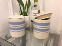 2 ceramic storage jars with lids