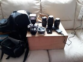 CANON CAMERA WITH TRIPOD BATTERIES BAGS AND LENSES.