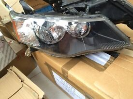 VW TIGUAN 2009 NEW GINUINE DRIVER SIDE AND PASSENGER SIDE O/S/N/S HEADLIGHTS