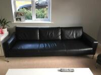 Large Black leather 3 seater sofa and foot stool