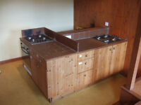 Three linked kitchen units with 3 gas hobs and electric oven, plus sink unit with double sinks
