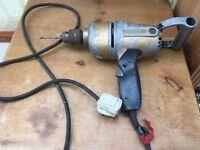Old Drill. Antique retro powertool. Vintage Black and Decker