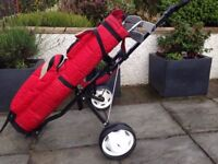Junior set of right handed golf clubs, trolley, bag, balls, tees and ball markers