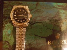 Rolex Oyster silver and gold black face