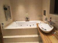 Double jacuzzi bath
