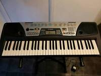 Yamaha PSR-175 with stand and a/c power.