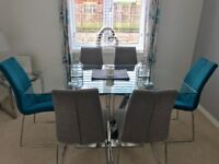 Glass and Chrome Dining Table and Chairs