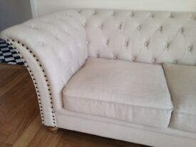 Cream Chesterfield style sofa