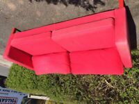 Red sofa with coffee table