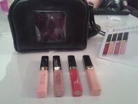 Elizabeth arden Lipgloss x 4 including leather pouch NEW GENUINE proof can be seen
