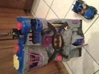 bat cave , batman figure on bike and bat man light and sound car