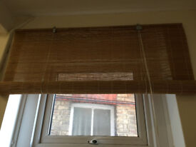 2 identical bamboo roller blinds