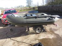 Bison inflatable fishing boat complete with bison outboard and a trailer