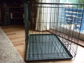 Black collapsible Dog Crate with washable plastic tray. Two doors and divider