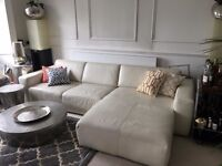 Corner sofa in soft white leather