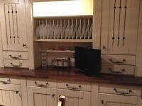 Classic fitted kitchen in cream wood with iron handles, granite and oak work surfaces & appliances