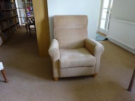 Reclining corduroy covered armchair. Very solid and very comfy.
