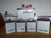 A 4-slice toaster plus matching bread , coffee, tea, sugar, biscuit and cutlery storage bins