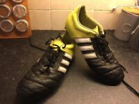 Used Adidas Black Leather Football Boot with yellow heel with moulded studs, good condition