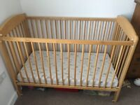 Wooden Cot. Two levels for up to 3 year olds with drop down front for easy access
