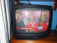 """Goodmans colour TV with remote and handbook. Screen 16"""" wide, 11"""" high. Good picture and condition"""