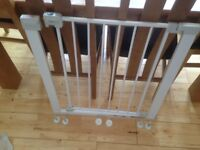 Baby gate with fixings.