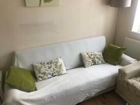 Compact sofa 2m x 0.75m with storage. Almost new. Hardly used