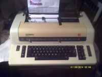 OLYMPIA TYPEWRITER ELECTRONIC ? ELECTRIC ? It HAS a DISC to CARRY the CHARACTERS ++++