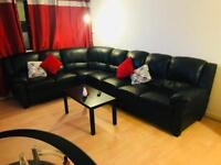 Black faux leather sofa