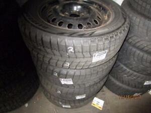 235/60R17 SET OF 4 USED BRIDGESTONE WINTER TIRES ON MULTI FIT RIMS