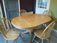 Pale wooden dining table and four chairs