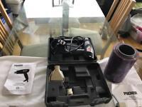 Packer - shrink wrap gun