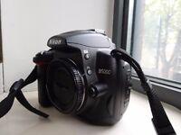 Nikon DSLR D5000 + 18-55mm lens + case. Low 5475 shutter count