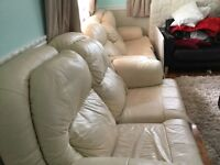 Two and three seater cream leather sofas