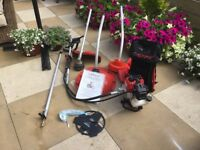 4 In 1 Strimmer,Mower,Brush Cutter And Blower In Excellent Condition Can Deliver
