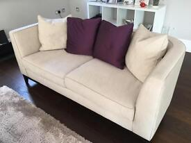 Cream sofa with back cushions
